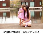 mother and daughter are... | Shutterstock . vector #1218449215