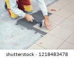 ceramic tiles. tiler placing...   Shutterstock . vector #1218483478
