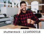 waist up of a handsome smiling... | Shutterstock . vector #1218500518