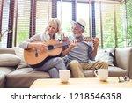 loving mature couple sitting on ... | Shutterstock . vector #1218546358