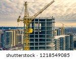 construction crane next to the...   Shutterstock . vector #1218549085