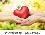 red heart in woman and man... | Shutterstock . vector #121859662
