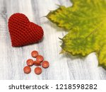 red knitted heart with pills... | Shutterstock . vector #1218598282