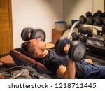 muscular young man  lifting... | Shutterstock . vector #1218711445