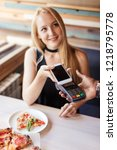blonde woman paying with smart... | Shutterstock . vector #1218795778