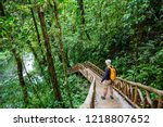 hiking in green tropical jungle ... | Shutterstock . vector #1218807652