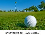 golf ball lies on edge of green - stock photo