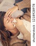 sick woman with seasonal... | Shutterstock . vector #1218928978