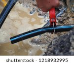 leaked poly pipes are being...   Shutterstock . vector #1218932995
