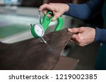 woman hands use leather... | Shutterstock . vector #1219002385