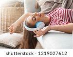 beautiful woman listening to... | Shutterstock . vector #1219027612