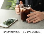 woman with glass cup of cold... | Shutterstock . vector #1219170838