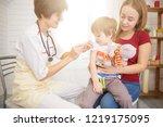 a doctor giving a child an...   Shutterstock . vector #1219175095