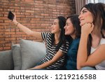 selfie together with friend is...   Shutterstock . vector #1219216588