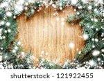christmas fir tree on a wooden... | Shutterstock . vector #121922455