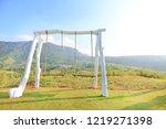 empty swing on hillside with... | Shutterstock . vector #1219271398