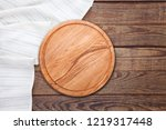 table cloth and pizza board on... | Shutterstock . vector #1219317448
