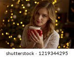 woman with cute red cup in... | Shutterstock . vector #1219344295