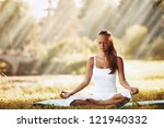 yoga woman on green grass in... | Shutterstock . vector #121940332
