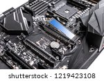 Hard disk SSD m2 on the motherboard background. Hard disk SSD m2 on the motherboard background. M2 technology can develop the speed of reading and writing information up to 3500 mbs.