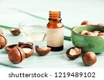 macadamia nuts on blue wooden... | Shutterstock . vector #1219489102