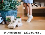little child girl is decorating ... | Shutterstock . vector #1219507552