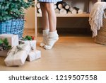 little child girl is decorating ... | Shutterstock . vector #1219507558
