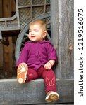 little girl in autumn park   Shutterstock . vector #1219516075