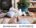 child girl is laying on warm... | Shutterstock . vector #1219518628