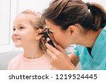pediatrician examining little... | Shutterstock . vector #1219524445