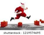 santa claus runs on the... | Shutterstock . vector #1219574695