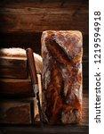 whole grain bread on wooden... | Shutterstock . vector #1219594918