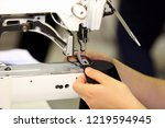 tailor sews on the sewing... | Shutterstock . vector #1219594945