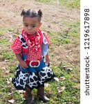 little cowgirl standing in the... | Shutterstock . vector #1219617898