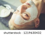face mask.beautiful young girl... | Shutterstock . vector #1219630432