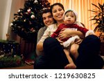 happy family sitting close to... | Shutterstock . vector #1219630825