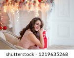 a young pretty brunette with an ... | Shutterstock . vector #1219635268