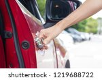 close up of hand opening car... | Shutterstock . vector #1219688722