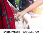 close up of hand opening car... | Shutterstock . vector #1219688725