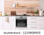 light modern kitchen interior... | Shutterstock . vector #1219808905