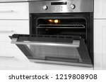 open modern oven built in... | Shutterstock . vector #1219808908