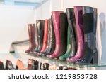 women's boots on the shelves in ... | Shutterstock . vector #1219853728