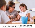 preschool teacher looking at... | Shutterstock . vector #1219858972