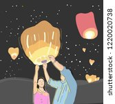 couple with sky lanterns in loy ... | Shutterstock .eps vector #1220020738