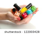 woman hands with nail polishes... | Shutterstock . vector #122003428