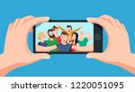 group selfie on smartphone.... | Shutterstock .eps vector #1220051095