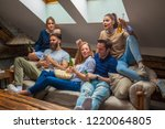 friends watching football game | Shutterstock . vector #1220064805