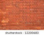 Old orange brick wall background. - stock photo