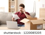 young man making call about... | Shutterstock . vector #1220085205