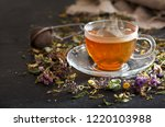 cup of herbal tea with various... | Shutterstock . vector #1220103988
